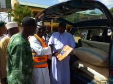 Fr. Lawrence presenting items to SEMA